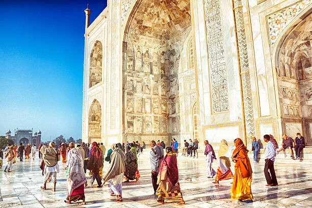 Tourists At The Taj Mahal Wall Art