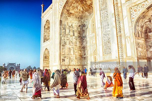 tourists at the taj mahal - taj mahal stock photos and pictures