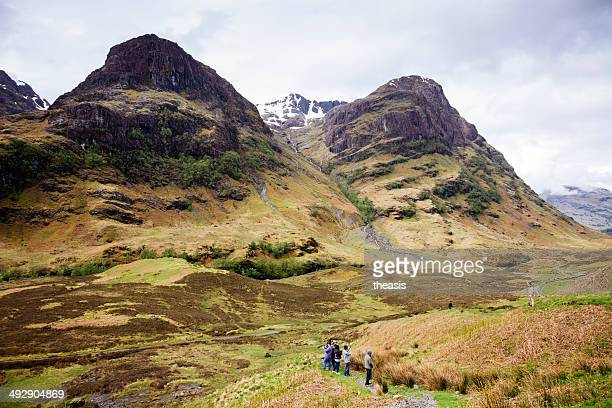 tourists at the three sisters and pass of glencoe - theasis stock pictures, royalty-free photos & images