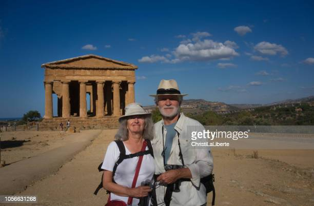 tourists at the valley of the temples, agrigento, sicily - agrigento stock pictures, royalty-free photos & images