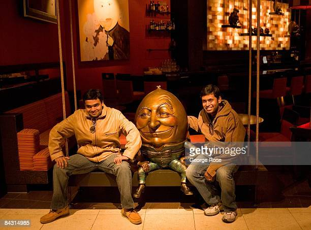 Tourists at the Venetian Hotel Casino pose with a fullsize sculpture of Humpty Dumpty in this 2009 Las Vegas Nevada interior photo