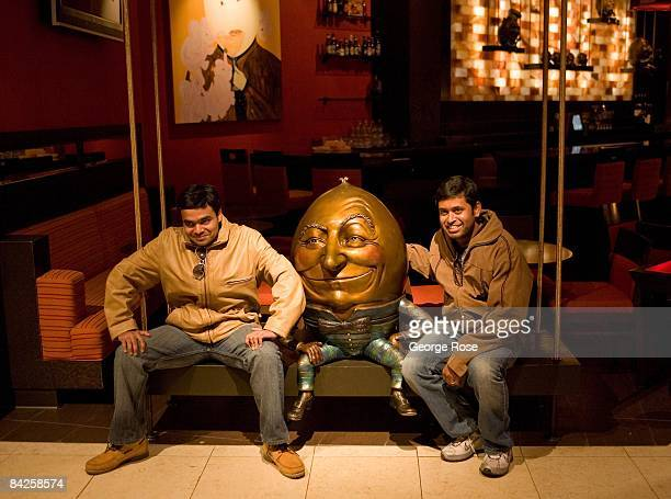 Tourists at the Venetian Hotel pose with a statue of Humpty Dumpty in this 2009 Las Vegas Nevada photo