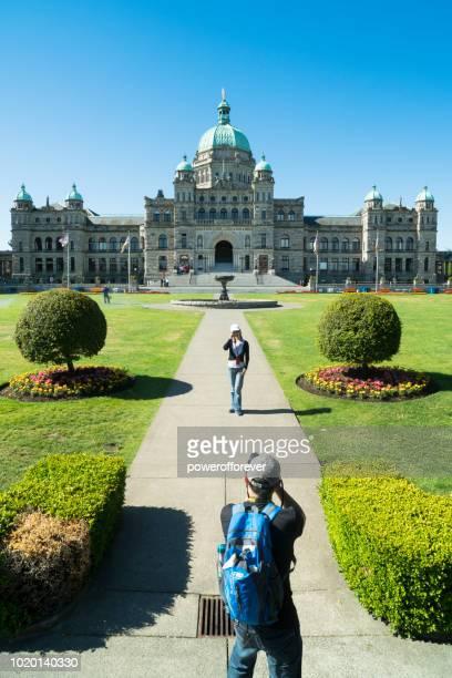 Tourists at Victoria Legislative Building in Victoria, British Columbia, Canada