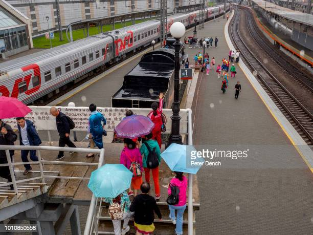 Tourists at Vladivostok station the termination point of the the TransSiberian Railway from Moscowk Spanning a length of 9289km it's the longest...