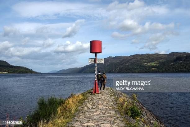 Tourists beside Loch Ness at Fort Augustus in Drumnadrochit, Scotland, on September 5, 2019.