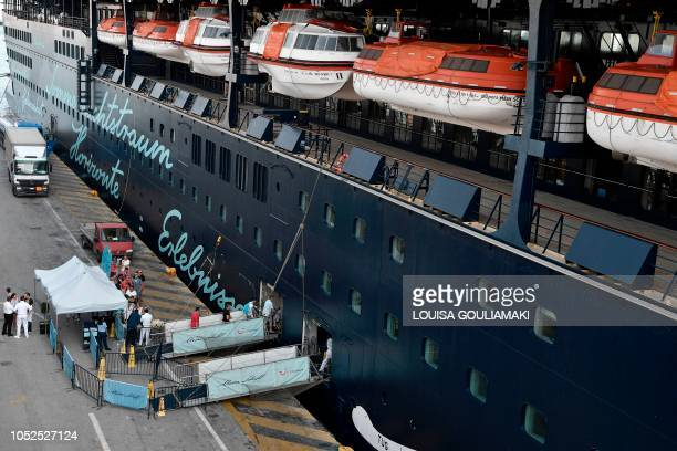 Tourists board a Cruise ship at the passenger terminal in the port of Piraeus on October 18 2018 Chinese shipping giant Cosco said it has ambitious...
