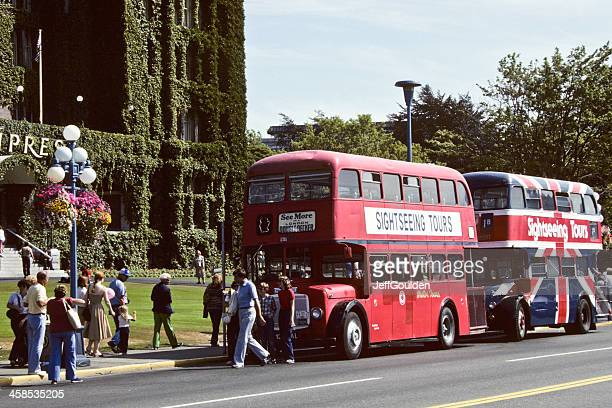 Tourists Board a Double Decker Bus at the Empress Hotel