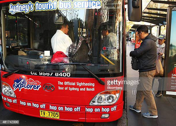 Tourists board a sightseeing bus in Sydney Australia on Tuesday July 21 2015 Tired hotels outdated attractions like Sydney's Darling Harbor and...