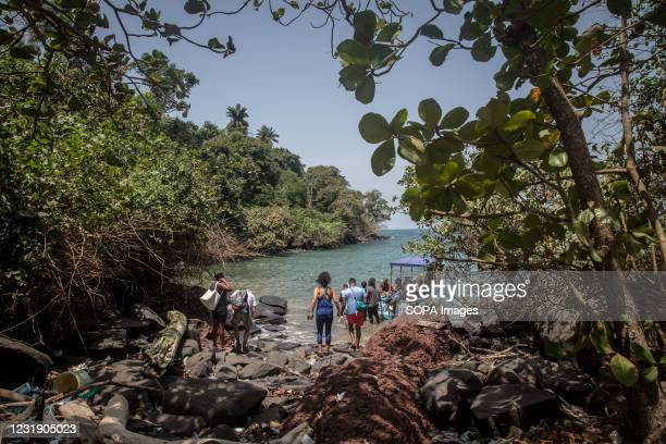 Tourists board a small boat on Sierra Leone's Banana Islands. The Banana Islands were once a slave trading port. They are now home to a few hundred...