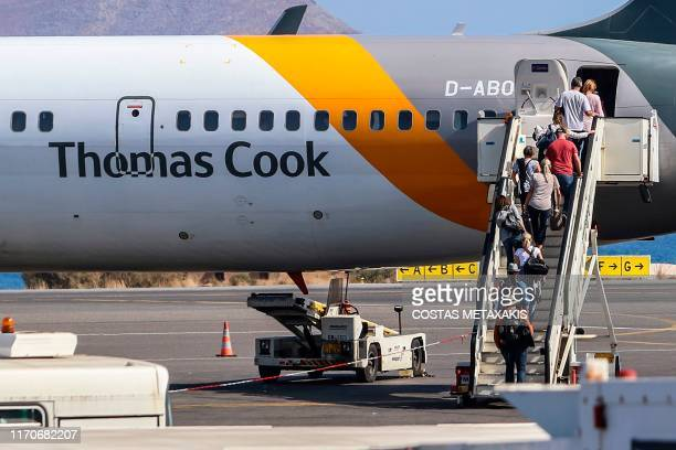 TOPSHOT Tourists board a Thomas Cook plane at the airport of Heraclion Crete island on September 24 2019 British travel firm Thomas Cook collapsed...