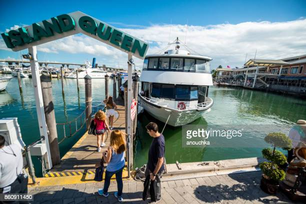 tourists boarding tour boat at bayside marketplace in miami downtown, usa - tourboat stock pictures, royalty-free photos & images