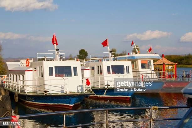 Tourists boats docked on the Yalu river inside North Korea.