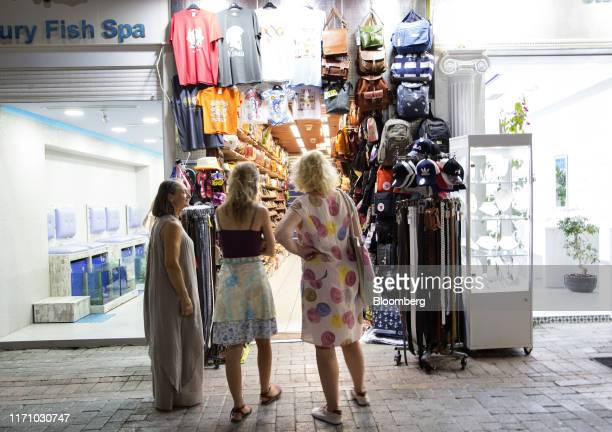 Tourists browse a gift store in Hersonissos, on the island of Crete, Greece, on Tuesday, Sept. 24, 2019. Like Crete, Europes other tourist hot-spots...