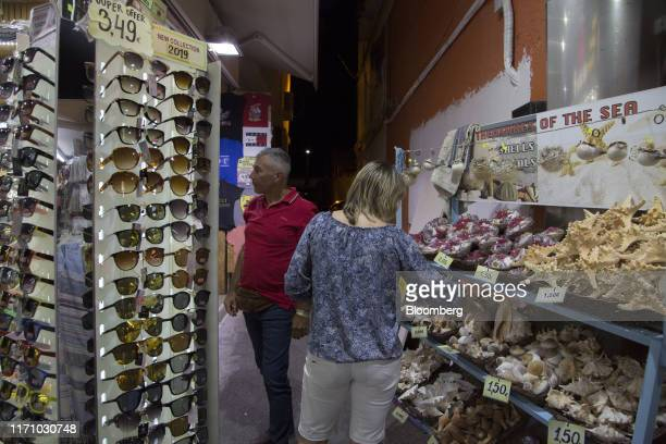 Tourists browse in a tourist gift shop in Hersonissos, on the island of Crete, Greece, on Tuesday, Sept. 24, 2019. Like Crete, Europes other tourist...