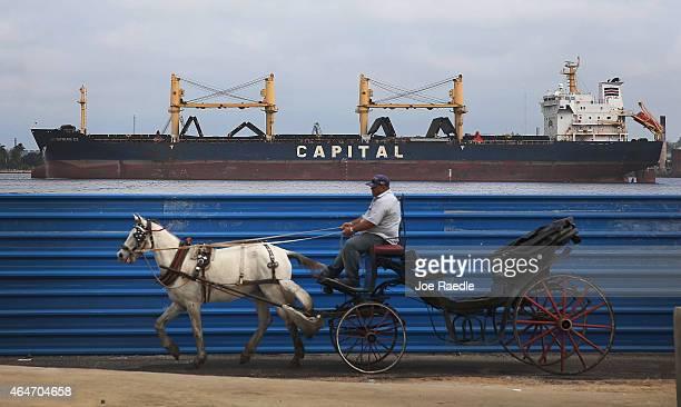 A tourists buggy is drawn by a horse as the second round of diplomatic talks between the United States and Cuban officials took place in Washington...