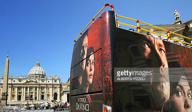 """Tourists bus covered with an advertisement for """"The Da Vinci Code"""" pictured in front of St. Peters's square at the Vatican, 12 May 2006. The movie..."""