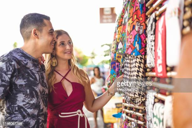 tourists buying at the craft fair - craft product stock pictures, royalty-free photos & images