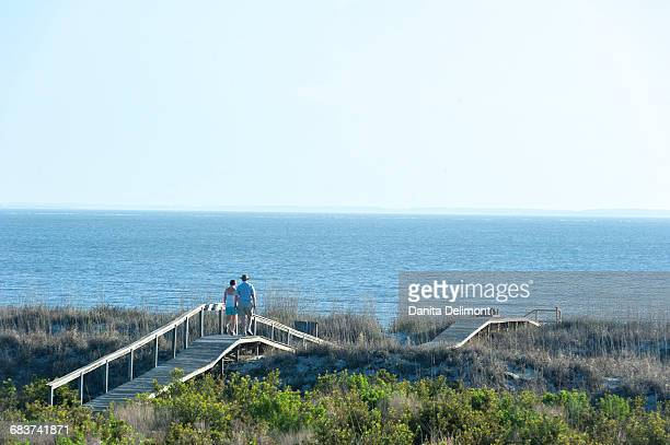 Tourists by Atlantic Ocean, Harbor Island, South Carolina, USA