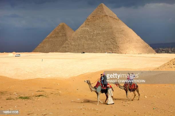 Tourists Camel Riding at Giza Pyramids