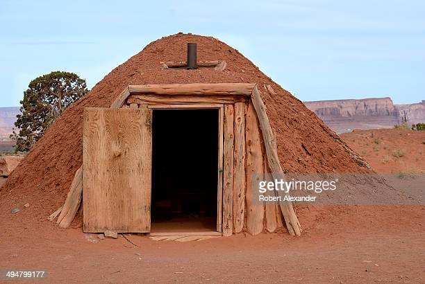 Tourists can enter a traditional Navajo home or hogan during a tour of Monument Valley Navajo Tribal Park in southeastern Utah Monument Valley a...