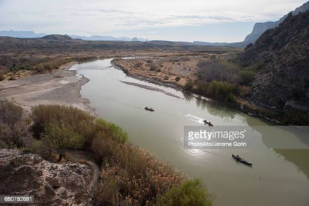 tourists canoeing on the rio grande in big bend national park, texas, usa - big bend national park stock pictures, royalty-free photos & images
