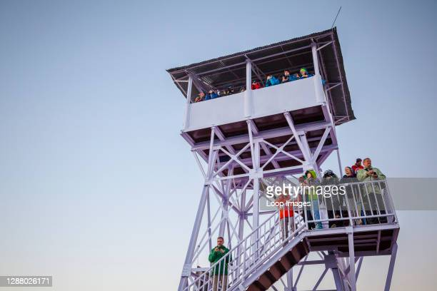 Tourists capturing sunrise in the observation tower at Poon Hill in Nepal.