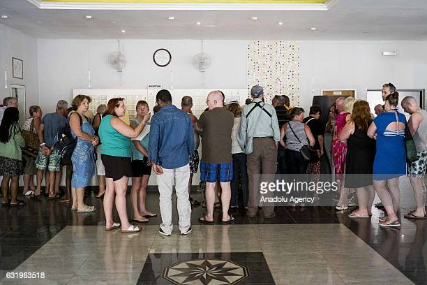 Tourists check out from Palma Rima Hotel before leaving the country after the state of emergency declaration by Gambian President Yahya Jammeh in...