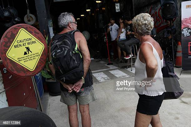 Tourists check out the ManShed Cafe Sanur The ManShed cafe in Sanur Bali is themed on an old style garage and is full of motorcycles and old cars...