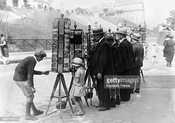 Tourists choosing poscards near the Sacre- Coeur basilica in August 1929 in Paris, France.