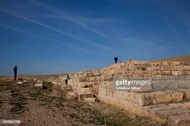Tourists climb on the Jerwan aqueduct built by King Sennacherib around 700 BC The aqueduct brought water to the city of Ninevah and was partially...