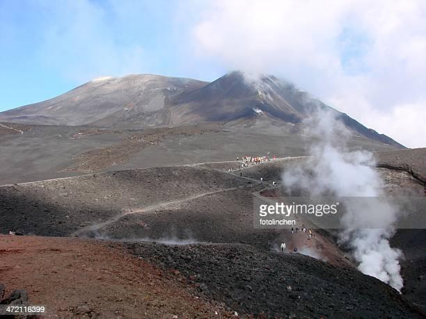 Tourists climbing Mt. Etna, Italy