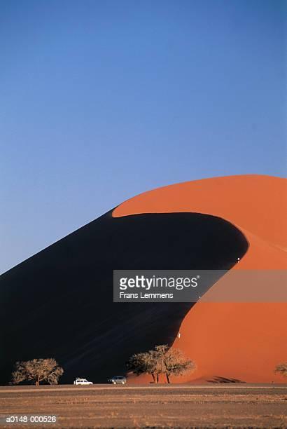 Tourists Climbing Sand Dune