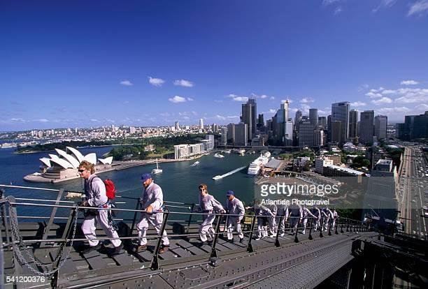 tourists climbing sydney harbour bridge - sydney harbour bridge stock pictures, royalty-free photos & images