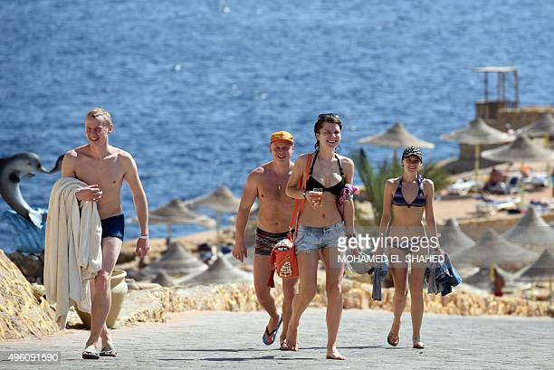 Tourists come back from the beach in the Egyptian resort of Sharm elSheikh on November 7 2015 Britain had on November 4 suspended all flights to and...
