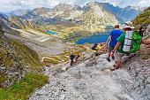 Tourists coming down from the Szpiglasowa Pass, Tatry mountains, Poland