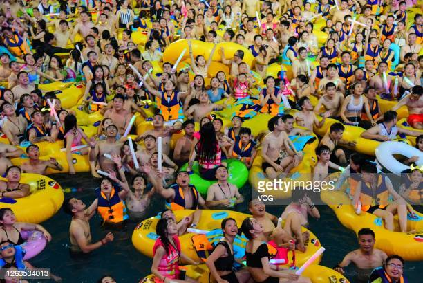 Tourists cool themselves in water during a lobster-themed electronic music party at a water park on August 01, 2020 in Hangzhou, Zhejiang Province of...