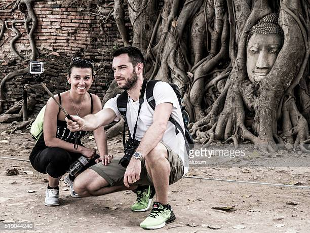 Tourists couple doing a selfie at a landmark in Ayutthaya
