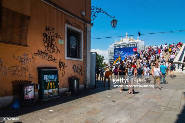 Tourists cross the bridge of Scalzi on the way to reach Rialto Bridge from railway station Santa Lucia through Santa Croce district on July 12 2018...