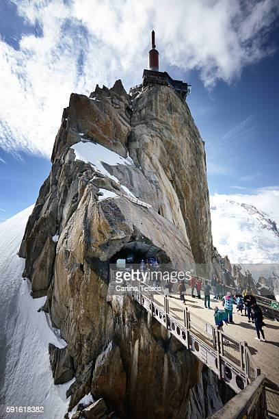 Tourists crossing a bridge at Aigulle de midi
