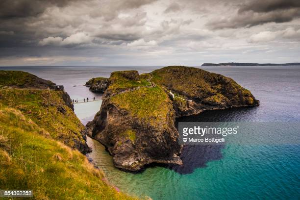 Tourists crossing the Carrick-a-Rede rope bridge, Northern Ireland