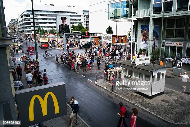 Tourists crowd around Checkpoint Charlie the most well known crossing point between East and West Berlin during the Cold War At Midnight on November...