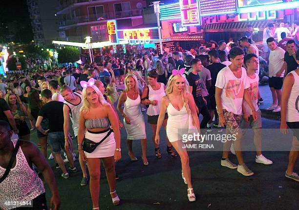 Tourists crowd in Punta Ballena street in Magaluf holiday resort in Calvia on the Spanish Mallorca Island on July 19 2014 Known among some tourists...
