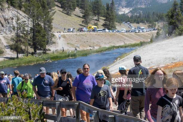 Tourists crowd in to theMidway Geyser BasinJuly 14, 2021 at Yellowstone National Park, Wyoming. Yellowstone is one of many national parks seeing...