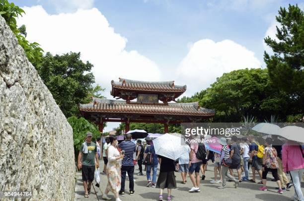 Tourists crowd near the Shureimon Gate of Shuri Castle in Naha Okinawa Prefecture southern Japan on June 20 2018 ==Kyodo