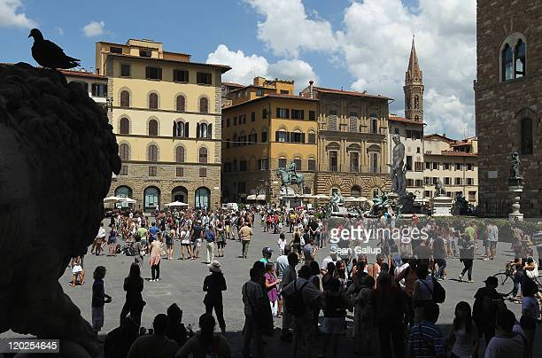 Tourists crowd Piazza della Signora square on July 22 2011 in Florence Italy Florence is among Italy's most popular tourist destinations