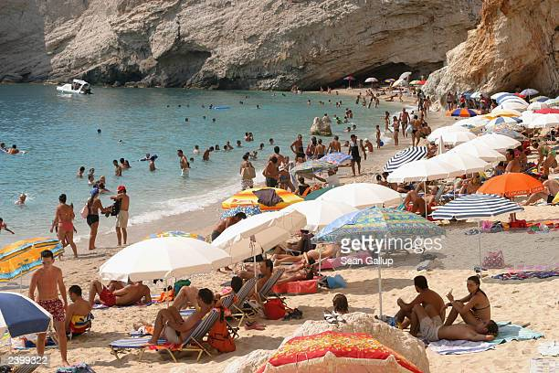 Tourists crowd Porto Katsiki Beach August 4 2003 on Lefkada Island in Greece Greece is one of Europe's chief summer tourist destinations