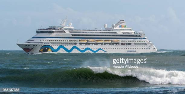 Tourists crowd the upper decks of Italy registered cruise ship 'AIDAvita' owned by Costa Crociere SpA and operated by AIDA Cruises as she sails into...