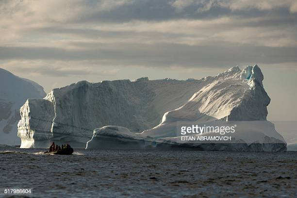 Tourists cruise close to icebergs in the western Antarctic peninsula on March 04 2016 The Antarctic tourism industry is generally considered to have...
