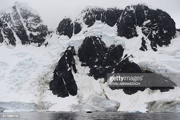 Tourists cruise the western Antarctic peninsula on March 03, 2016. The Antarctic tourism industry is generally considered to have begun in the late...