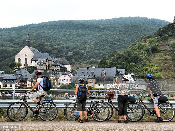 CONTENT] Tourists cycle along the roads on the Moselle